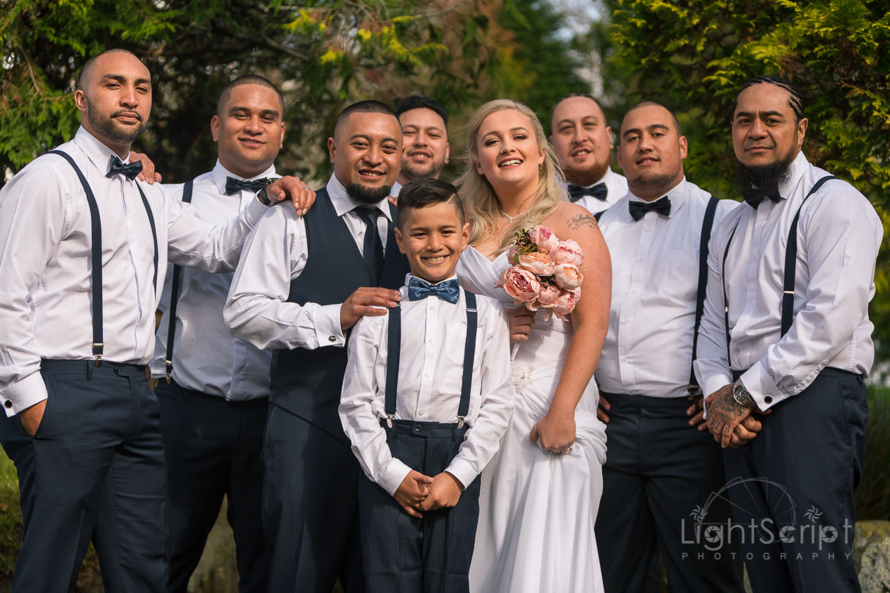 couple and groomsman