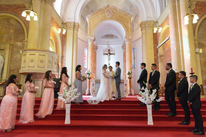 bride in groom waiting priest