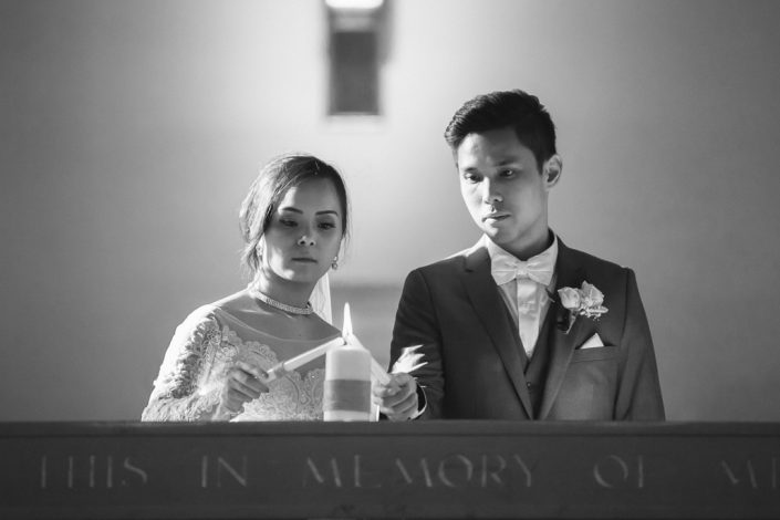 bride and groom with candle