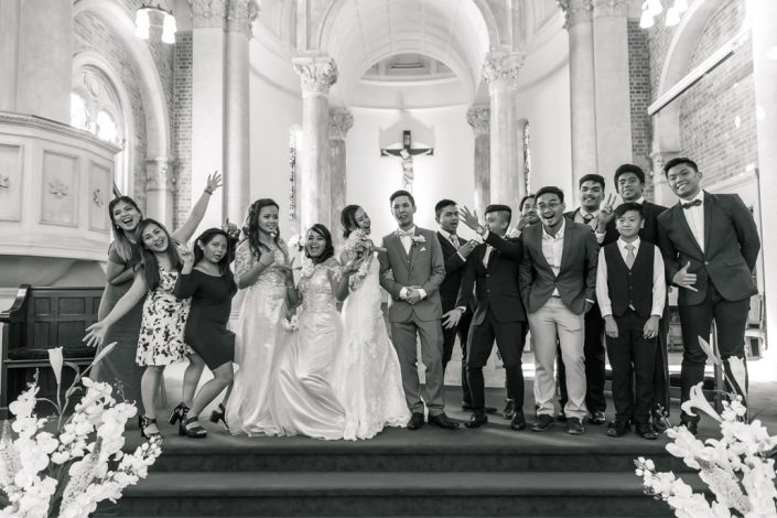 bridal party having fun in church