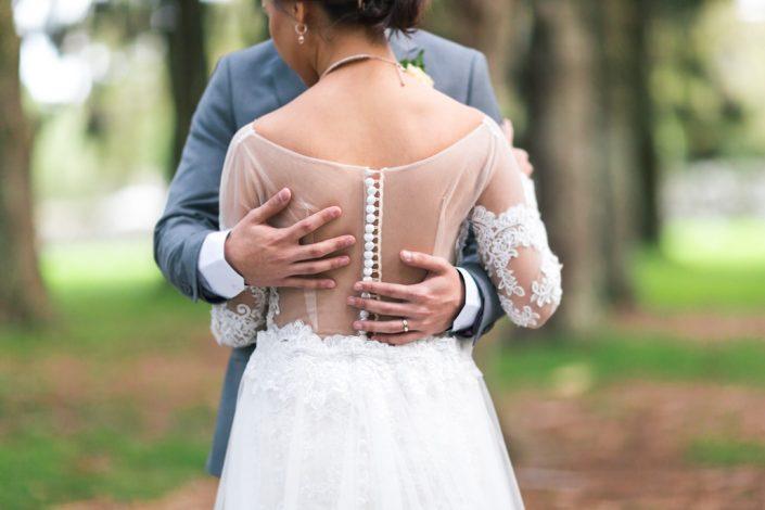 grooms hands on bride