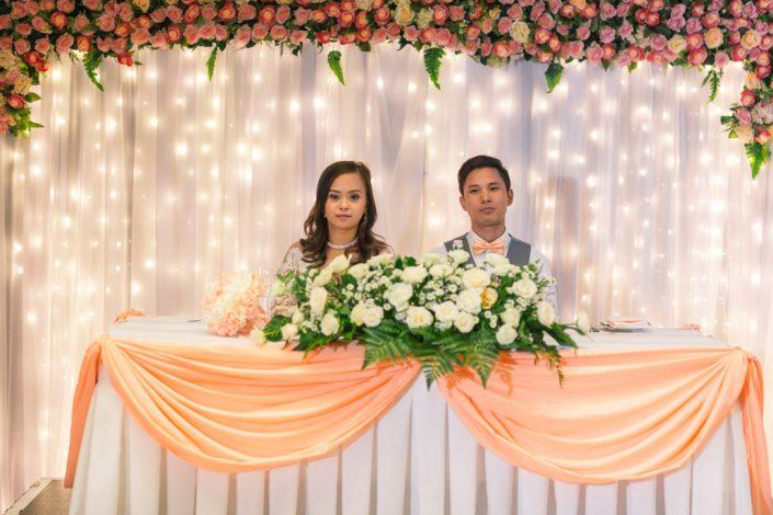 bride and groom behind table